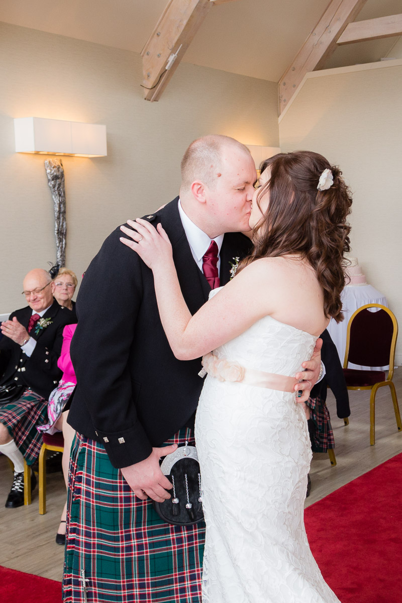 Bride and Groom's first kiss at Forbes of Kingennie