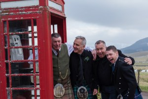 Groom and friends at the red phone box at the Glen Clova Hotel