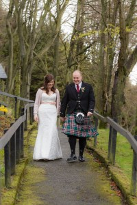 Bride and Groom walking at Forbes of Kingennie
