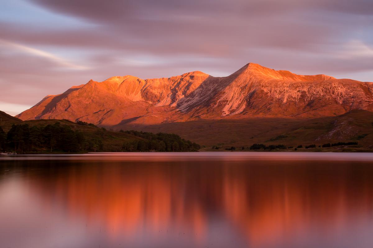 Beinn Eighe reflects on Loch Clair at sunrise