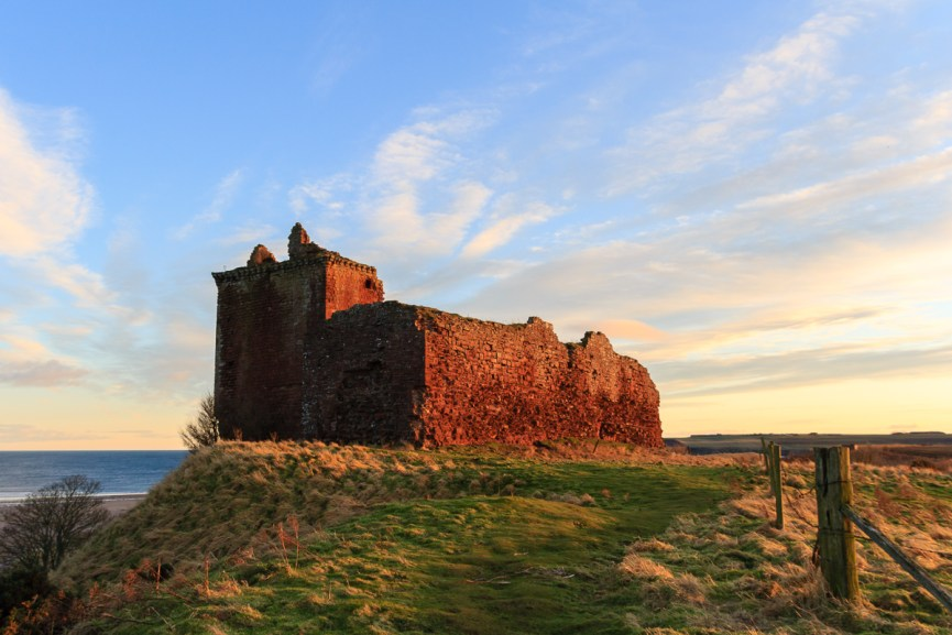 Red Castle, Lunan Bay lit up by the sunset