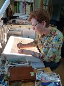 Anne working on Silverpoint calligraphy for Book 3 - the thoughts of Nelson Mandela about building peace