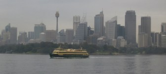 The Manly Ferry passing by the tall towers of Sydney (Photo copyright: Anne Lawson 2014)