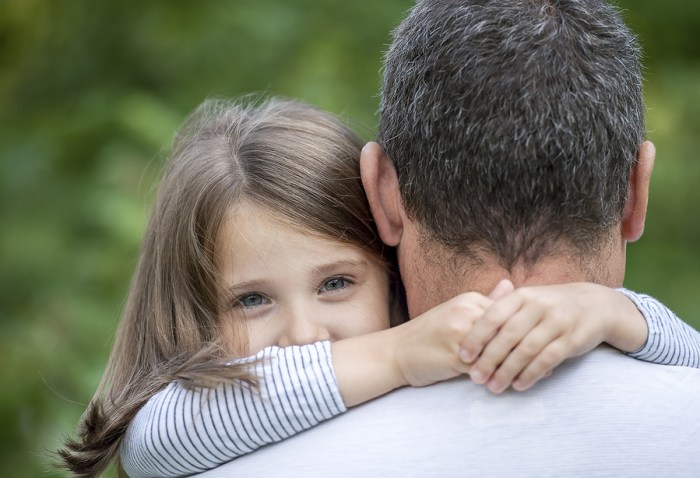 Unconditional Love Understood - Girl Hugging Dad