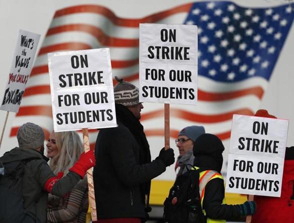 Striking  Denver  teachers,  district  resume  settlements