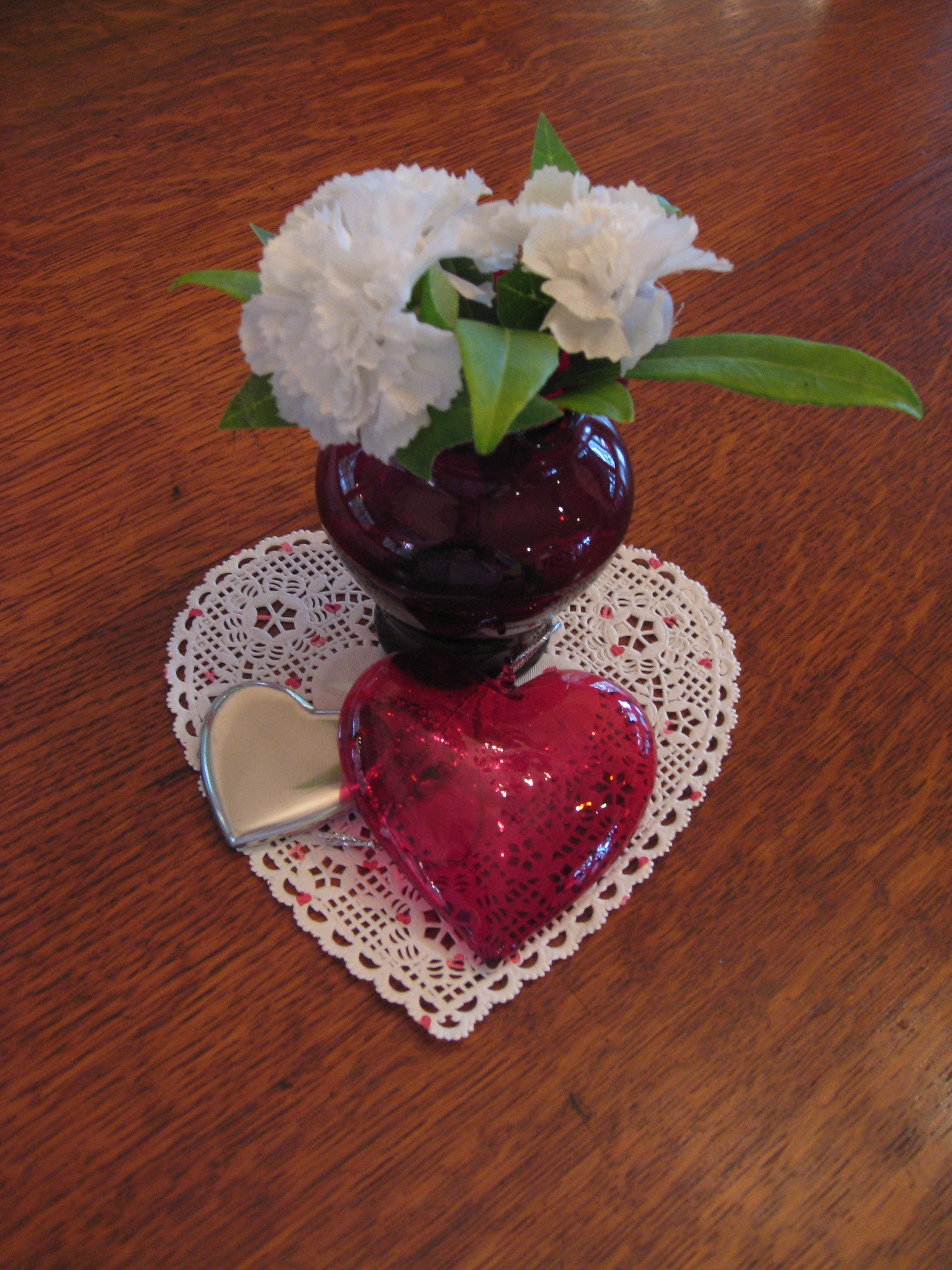 Small red vase with white carnations