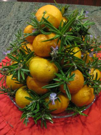 Christmas Table Decoration of Mandarin Oranges & sprigs of greenery