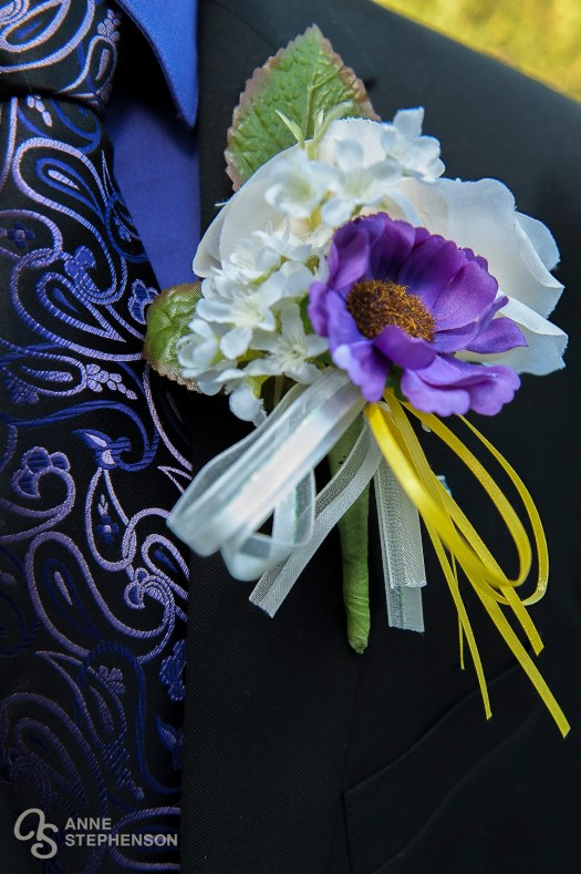 A blue and purple color palette adds sophistication to an outdoor wedding.
