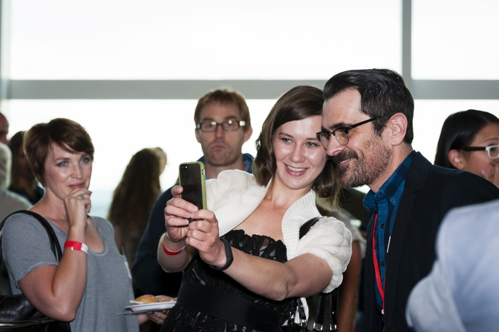 Ty Burrell poses with guests taking selfies at KUER's Savory Salt Lake 2015.