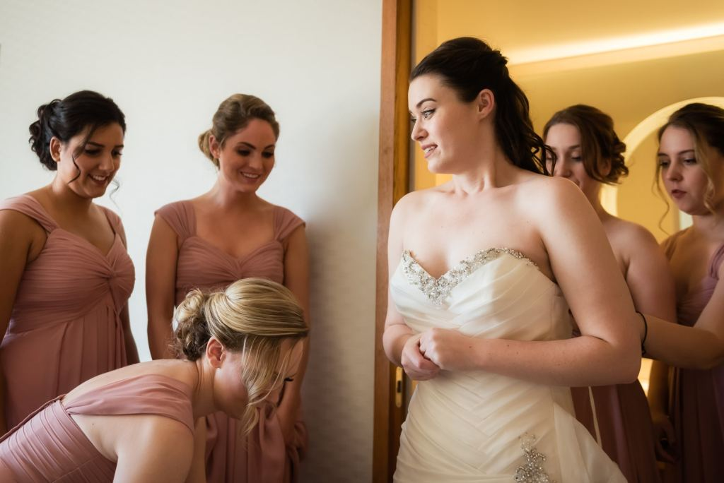 A bride nervously gets ready with her attendants.