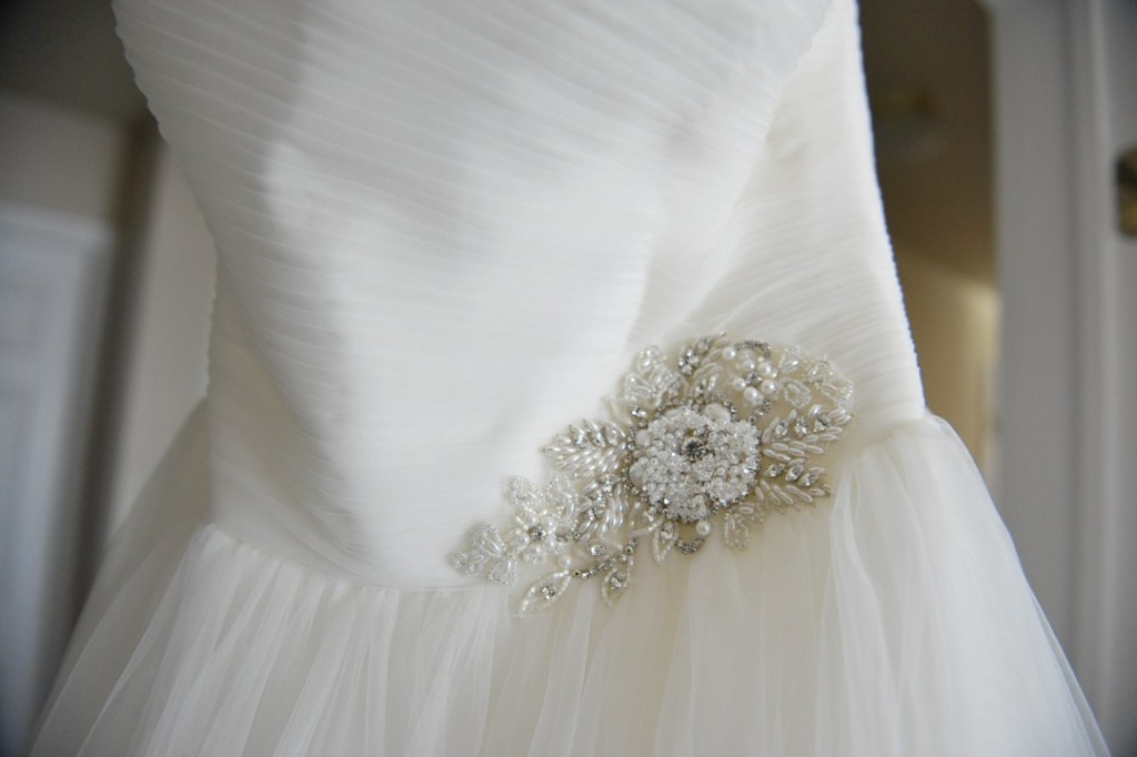 Hand sewn beads decorated the waist of this bridal gown.