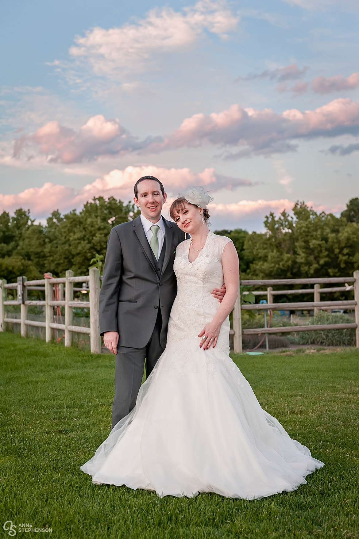 The bride and groom in front of a garden. The bride wore a 1920s inspired dress and veil.