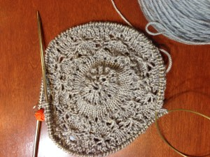 The beginning goes so fast!  The center is really pretty.  Once the shawl gets big, the center gets a bit lost, so I like to appreciate it at this point.