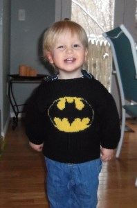 "Owen, modeling the ""Batman"" sweater that Gramma Mary knit for him.  That is a happy, handsome superhero, if I ever saw one."
