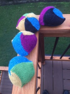 4 knitted knockers, Annetarsia ITR, with various Skacel yarns.  Size 4 dpns used to knit them, stuffed with poly fiberfill.
