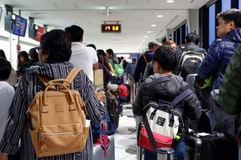 タイに戻る旅行客