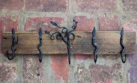 forged hooks on barnwood