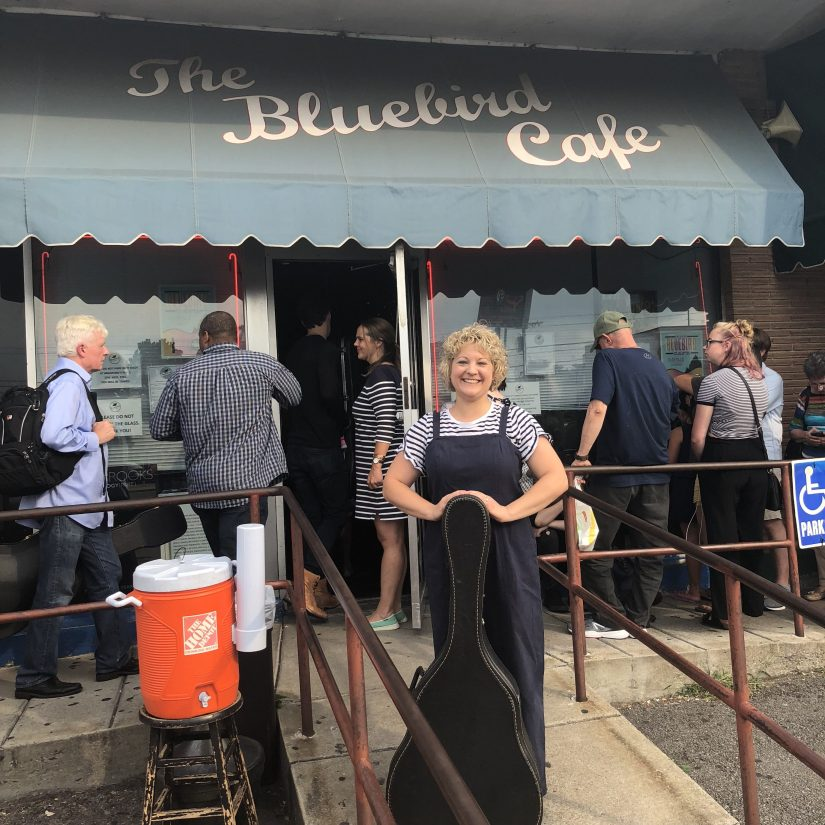 Outside the Bluebird Cafe with my guitar