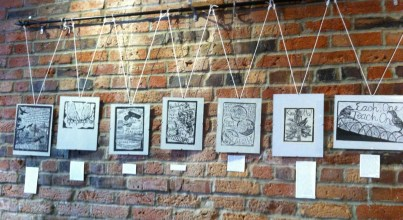 Prints on the wall at Solstice.