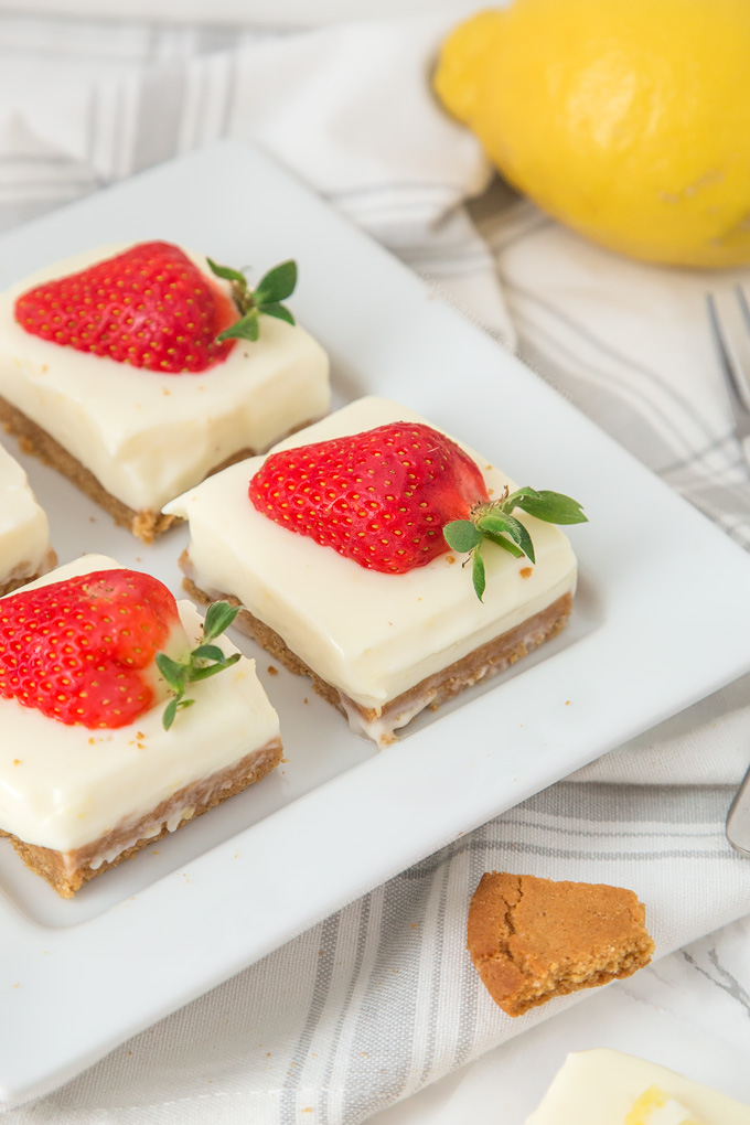 These creamy Lemon and Ginger Cheesecake Bars are easy to make and pack a real flavour punch with their gingersnap crust and zest filled cheesecake top!