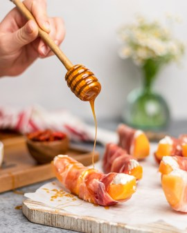Calabrian Chili-Infused Hot Honey with Prosciutto & Ricotta Wrapped Melon
