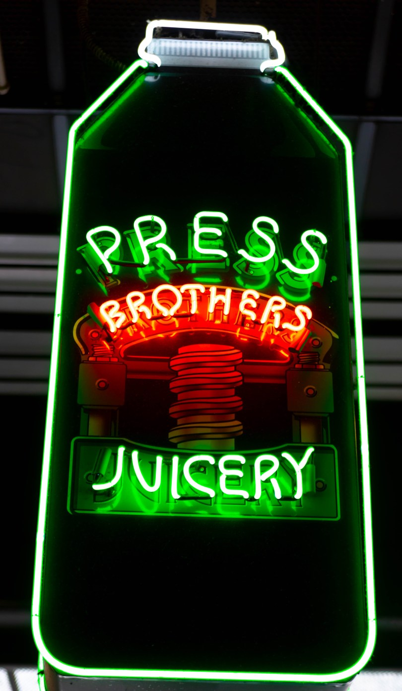 Neon Signs at Grand Central Market in Los Angeles Press Brother's Juicery