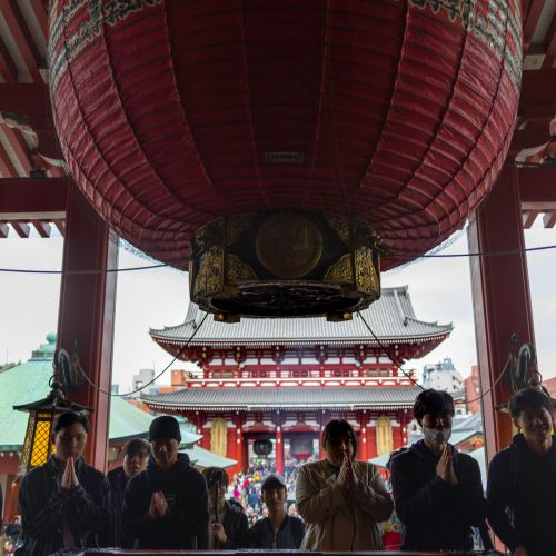 People Offer Prayers and Money to Buddhist Goddess of Mercy Kannon Senso-Ji Temple Asakusa Kannon Buddhist Temple in Tokyo, Japan Shrine with Massive Red Japanese Paper Lanterns Near Tokyo Sky Tree Goddess of Mercy by Annie Fairfax Where to Visit Tokyo Things to do In Tokyo, Japanese Travel Tourism Trip Inspiration Pictues of tokyo Japan