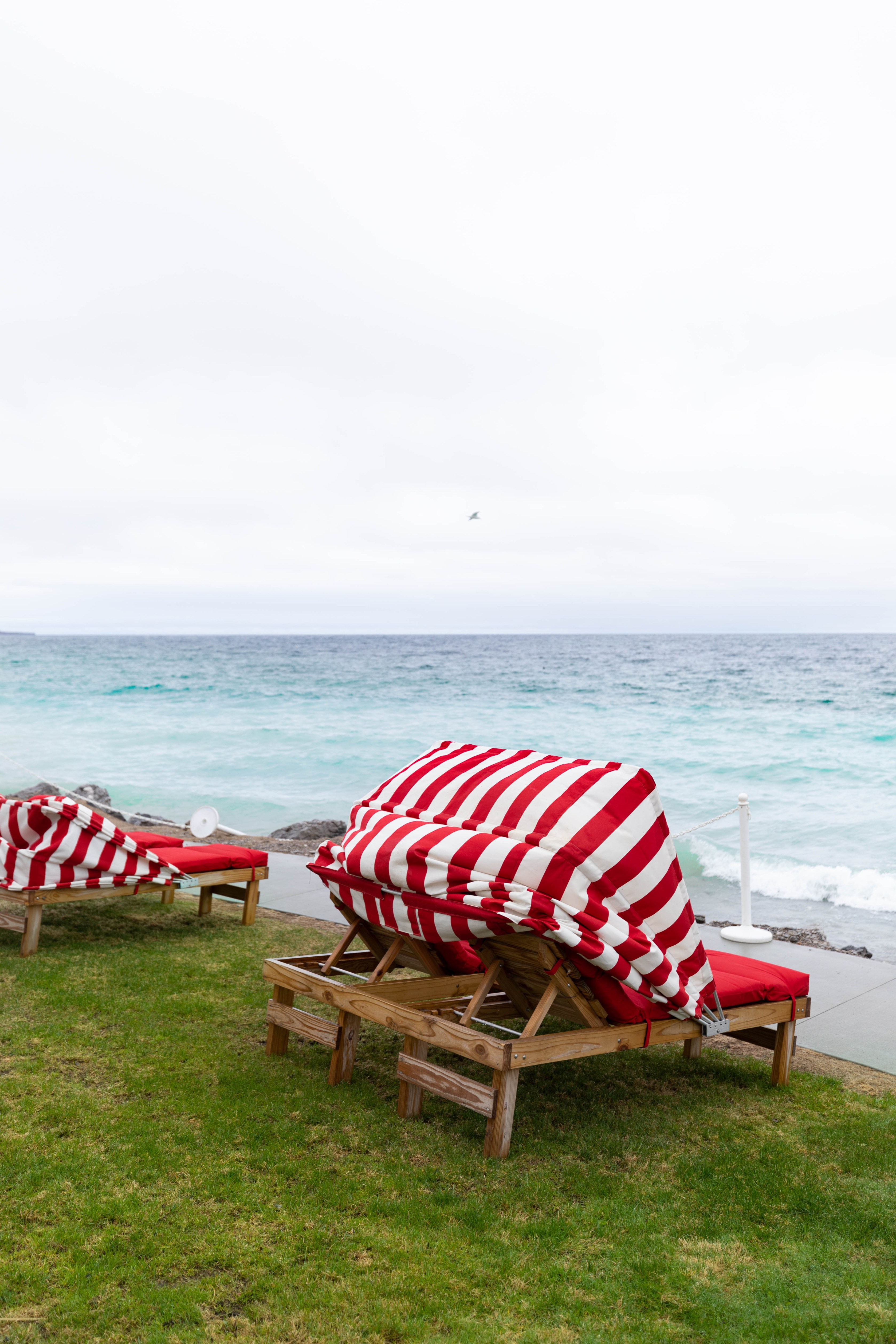Red and White Striped Beach Chairs at The Inn at Bay Harbor Autograph Collection Hotel in Bay Harbor Northern Michigan Petoskey Area Luxury Hotels of the World Top 500 Hotels in the World by Annie Fairfax