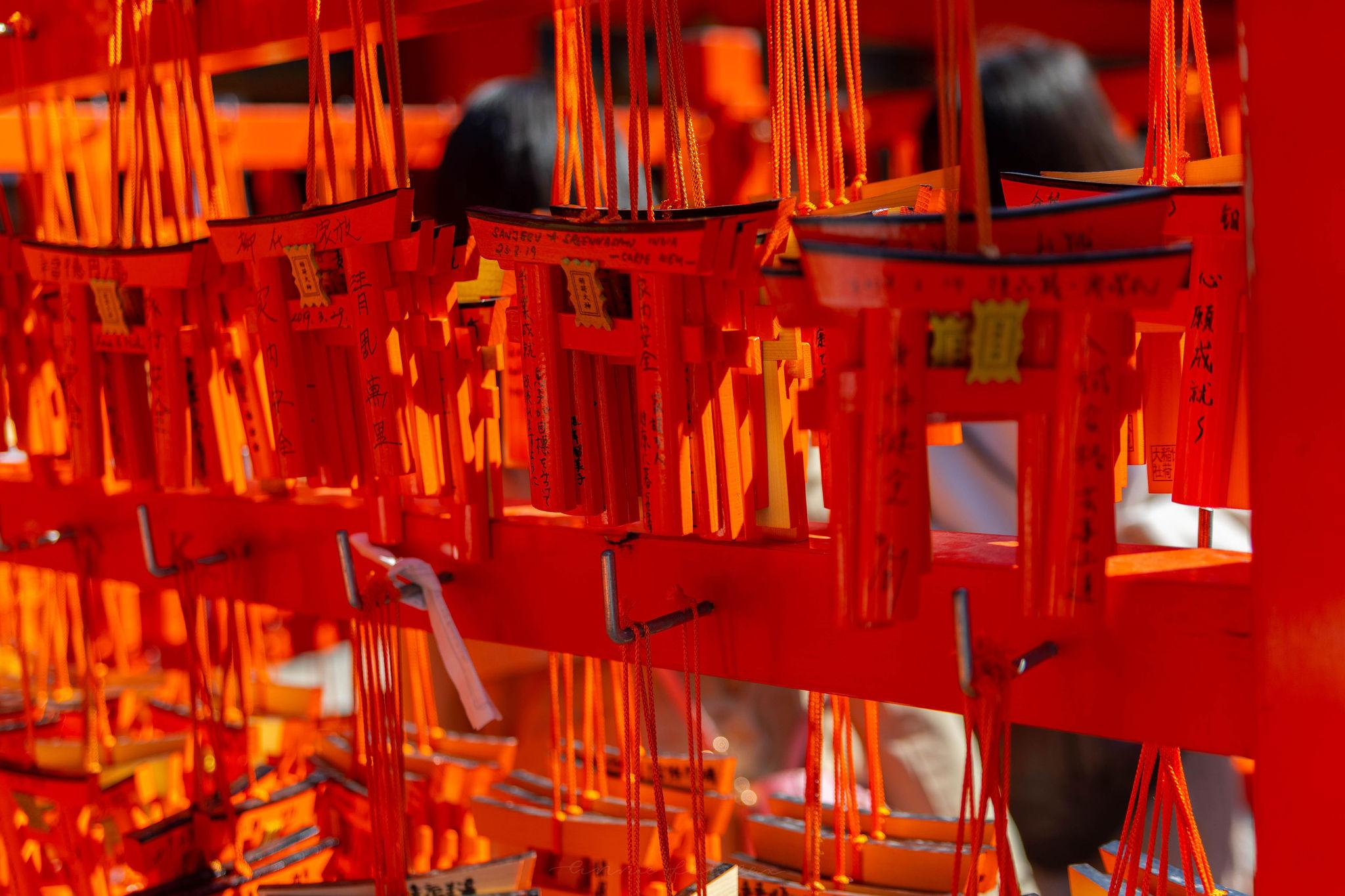 Wooden Ema Wishing Tablets Japanese Shinto Shrine Prayers Red Torii Gate Shape at Fushimi Inari Taisha in Kyoto