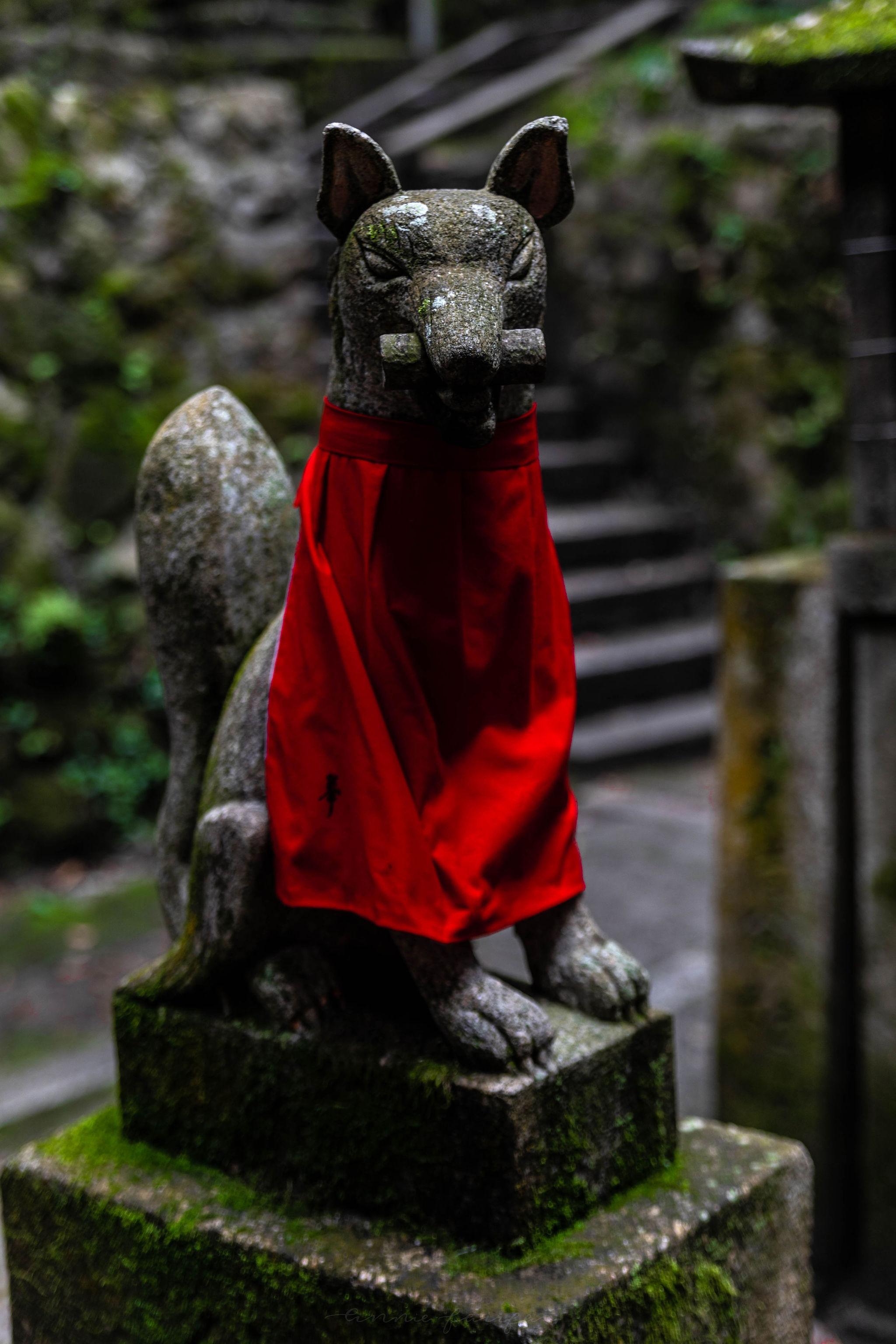 Fox Spirit Statue Kitsune at Fushimi Inari Taisha Shrine in Kyoto Japan