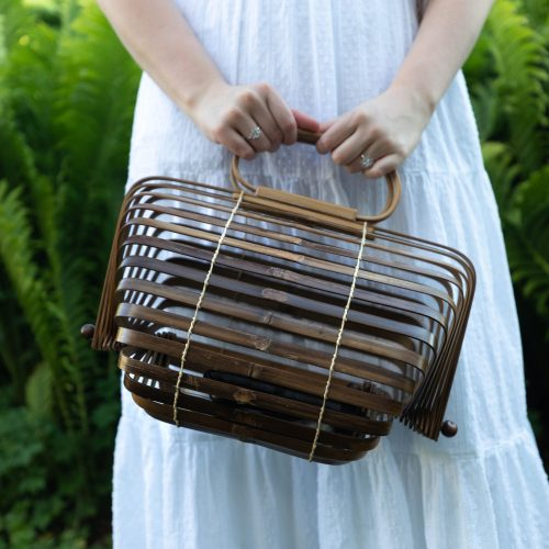 A Breezy White Swiss Dot Duffield Lane Maxi Dress Cult Gaia Basket Bag Wooden Shell Earring by Annie Fairfax
