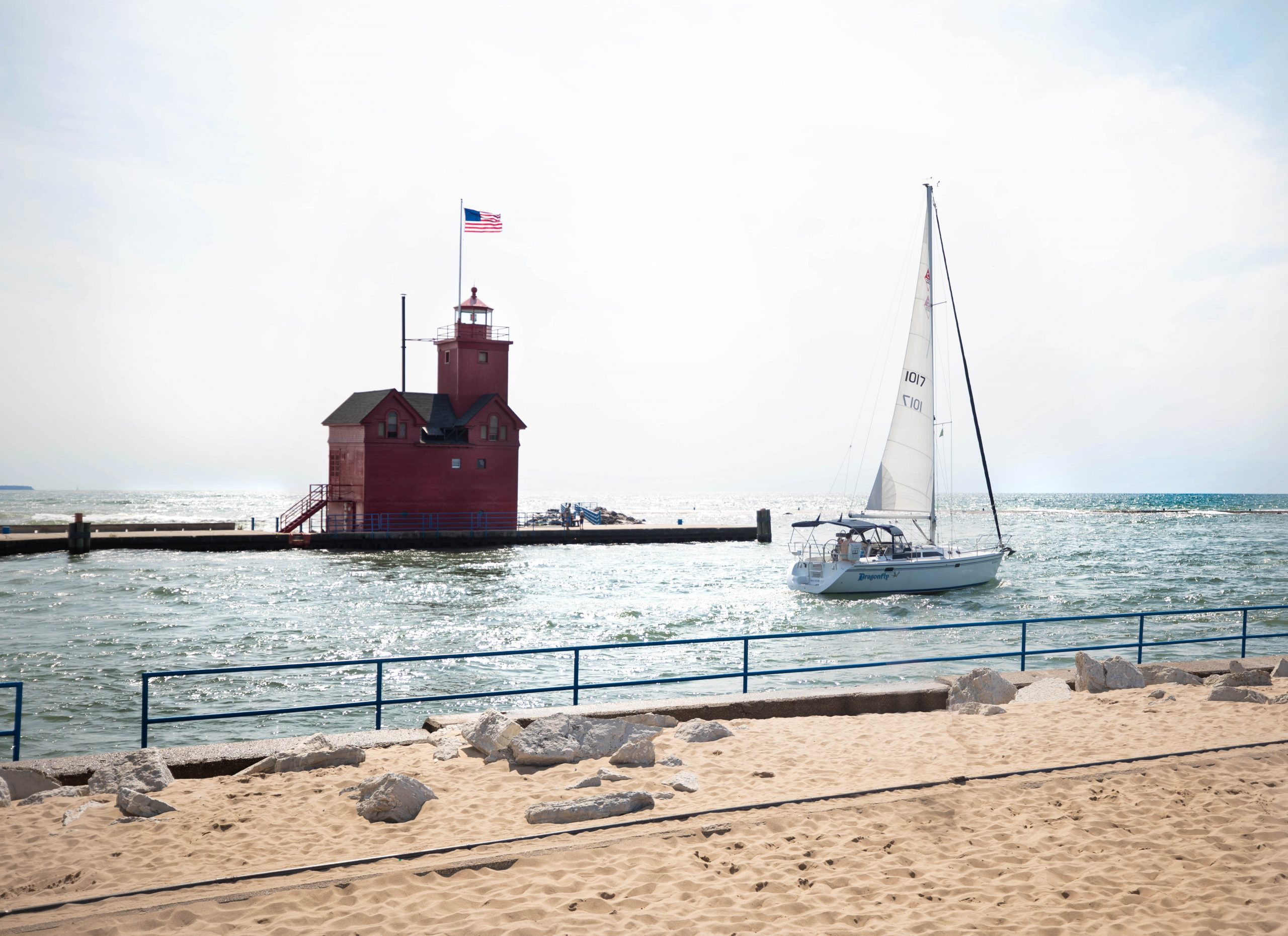 Holland State Park Red Lighthouse Holland Harbor Lighthouse and Sailboat by Annie Fairfax