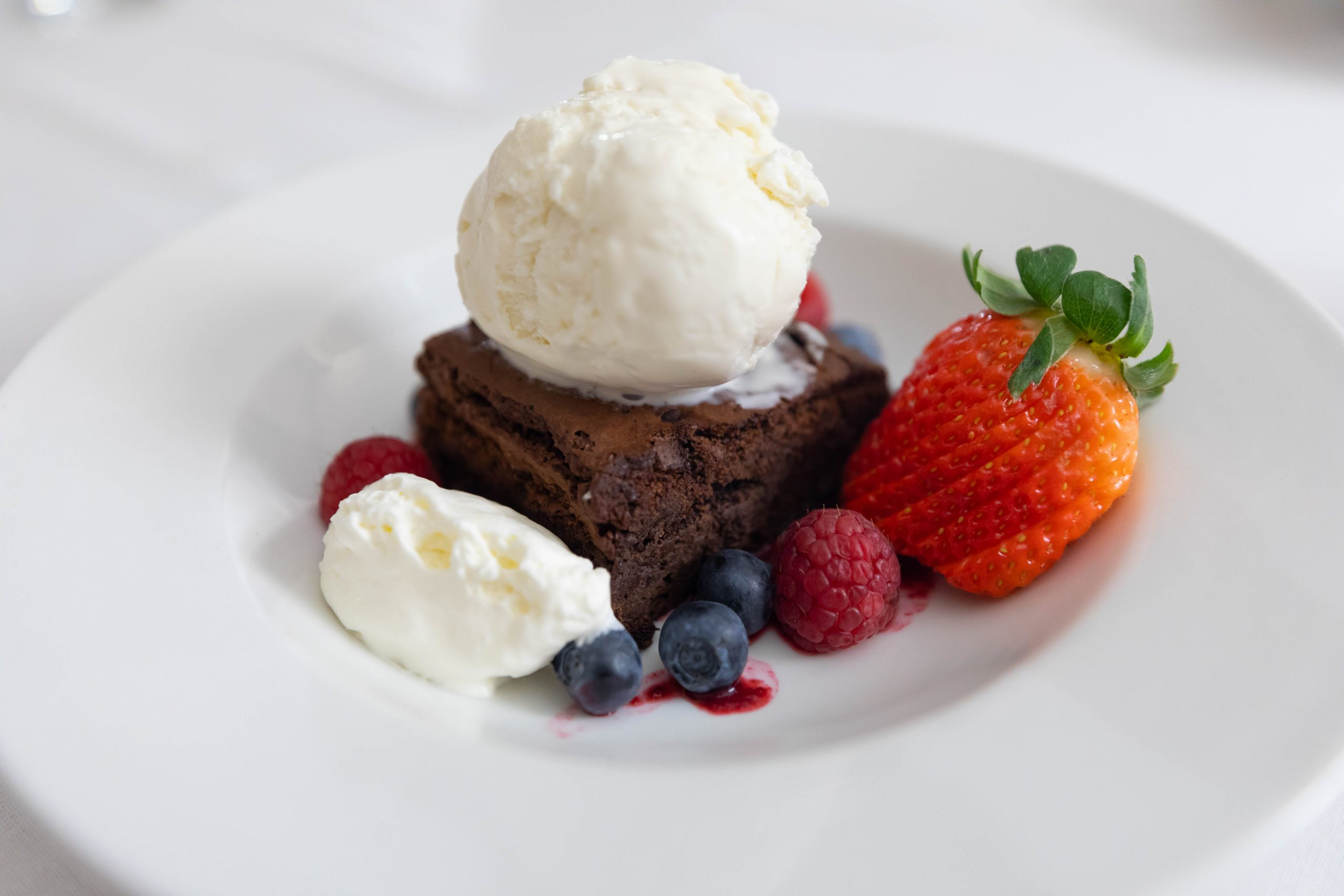 Chocolate Brownie Aerie Restaurant at Grand Traverse Resort & Spa in Acme Traverse City Michigan Photographed by Annie Fairfax Chocolate Brownie with Vanilla Ice Cream and Fresh Berries
