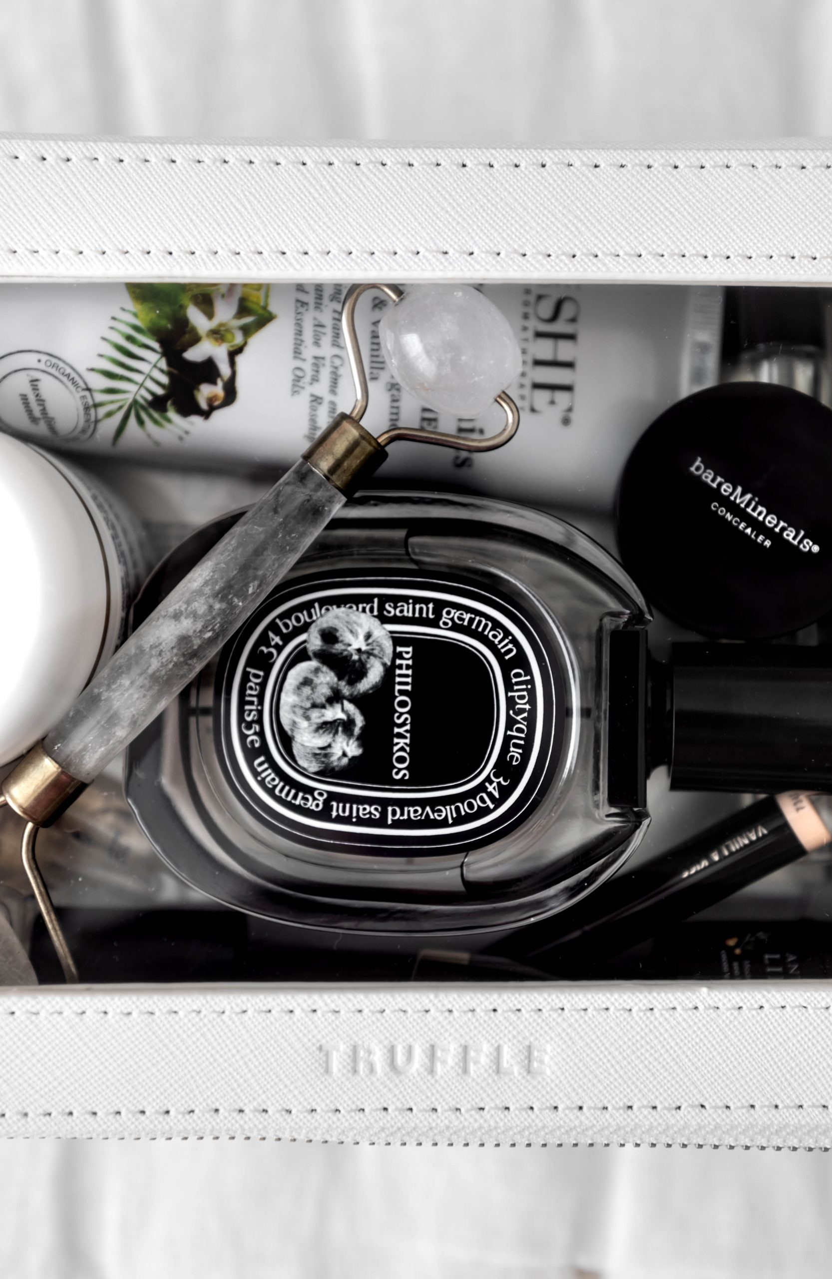 How I Pack My Cosmetics When I Travel Using Truffle Diptyque Perfume Bare Minerals Concealer Biologique Recherche Creme Verte Espoir, Annmarie Cosmetics Resorative Manuka Honey Cleansing Oil Travel Essentials by Annie Fairfax