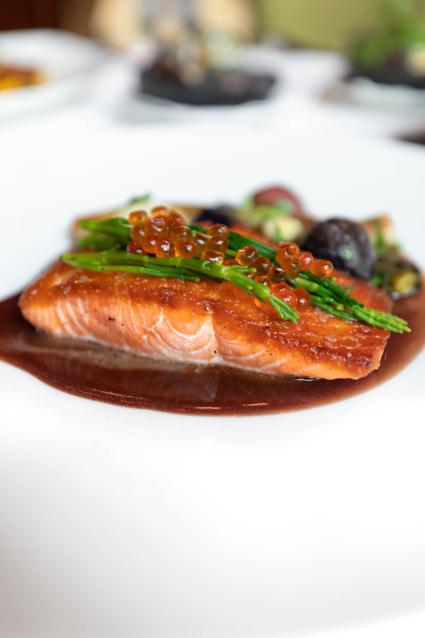 Ōra King Salmon at Charleston Grill from Chef Michelle Weaver Inside Belmond Charleston Place Luxury Hotel Written & Photographed by Annie Fairfax