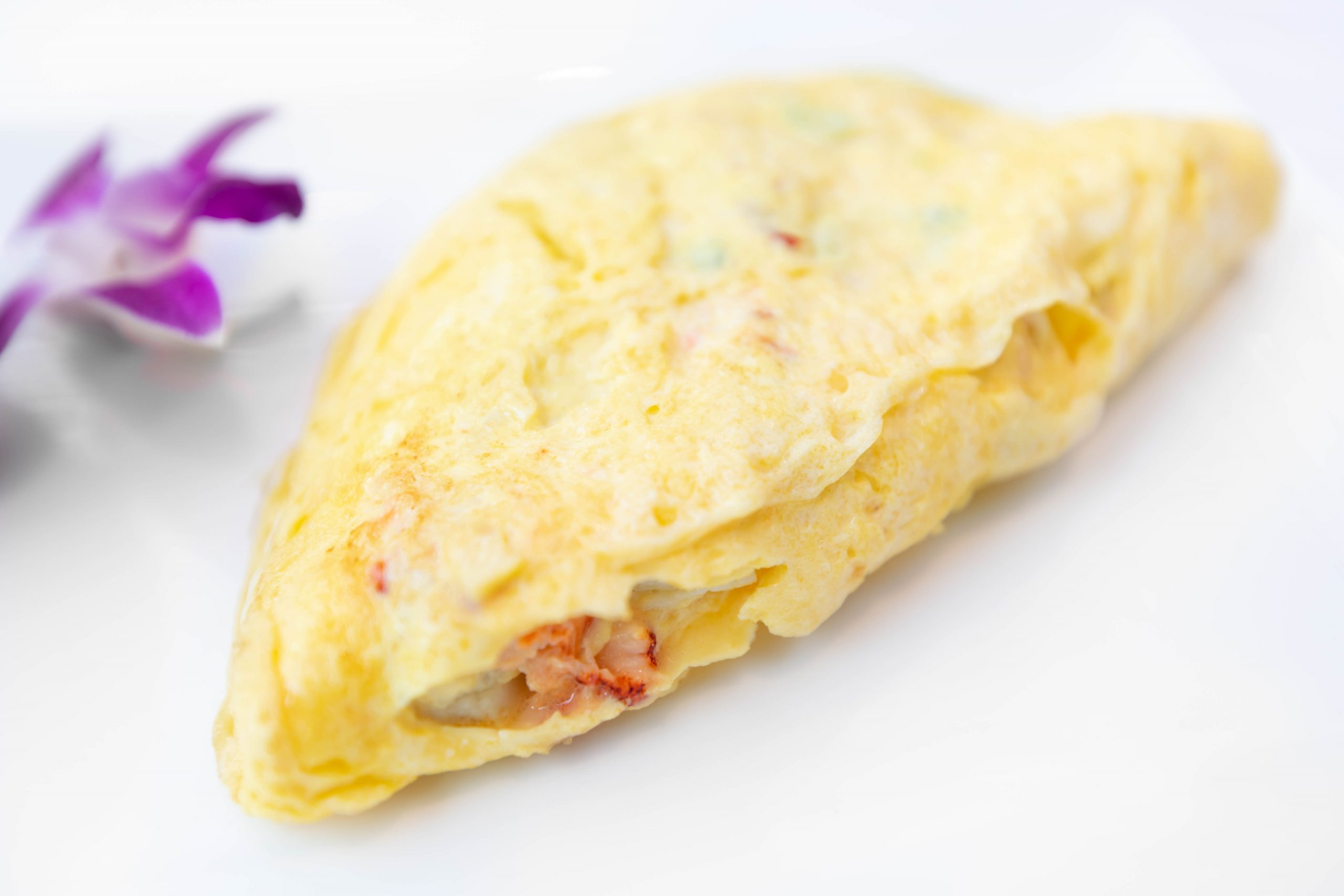 Palmetto Omelet with Lump Crab and Lobster at Palmetto Café Inside Belmond Charleston Place Luxury Hotel Written & Photographed by Annie Fairfax