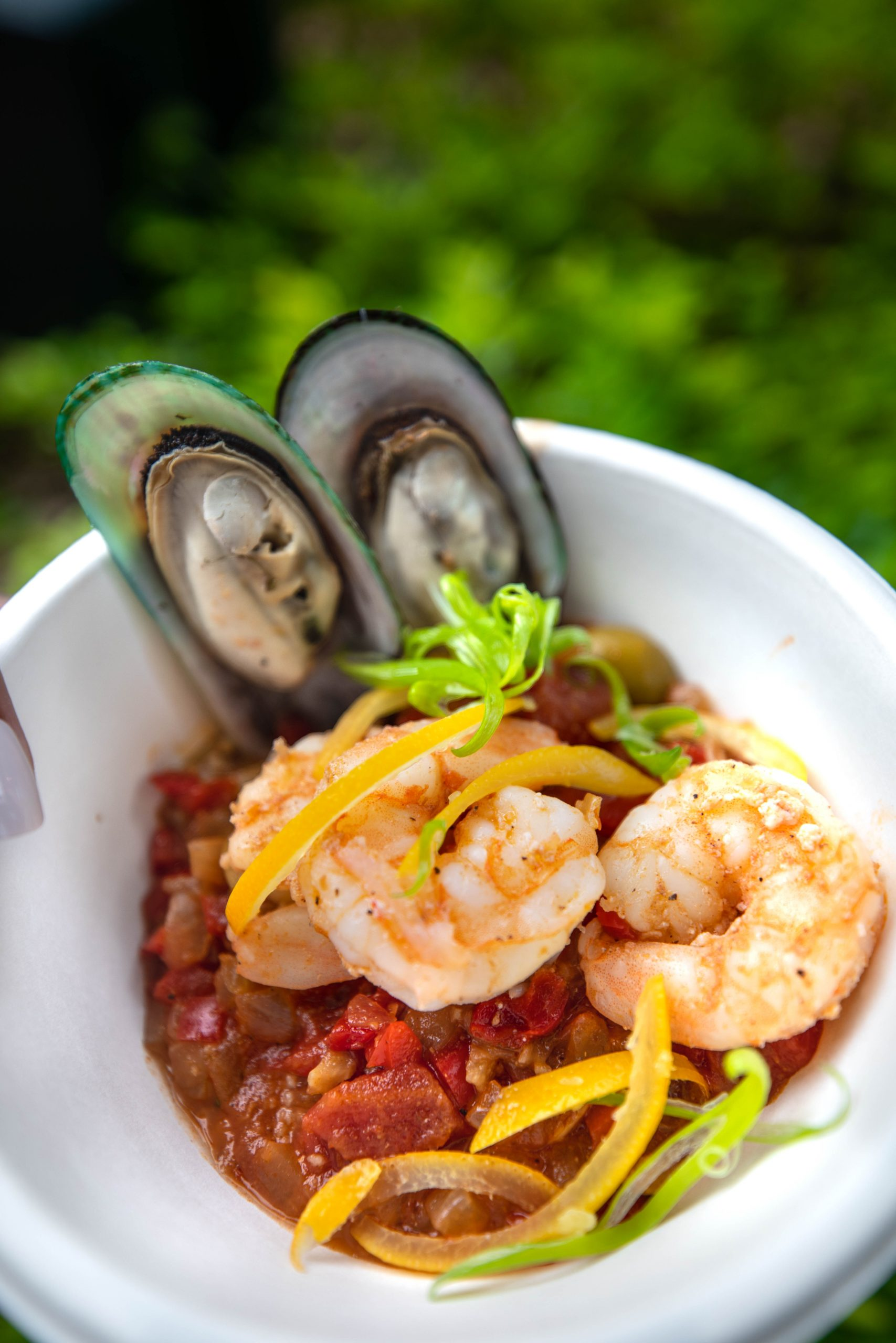 Moroccan Seafood Couscous with Shrimp, Mussels, Olives, Preserved Lemon, and Anchovy Breadcrumbs from La Isla Fresca between Morocco and France at Epcot in Walt Disney World Orlando Florida Photographed by Annie Fairfax