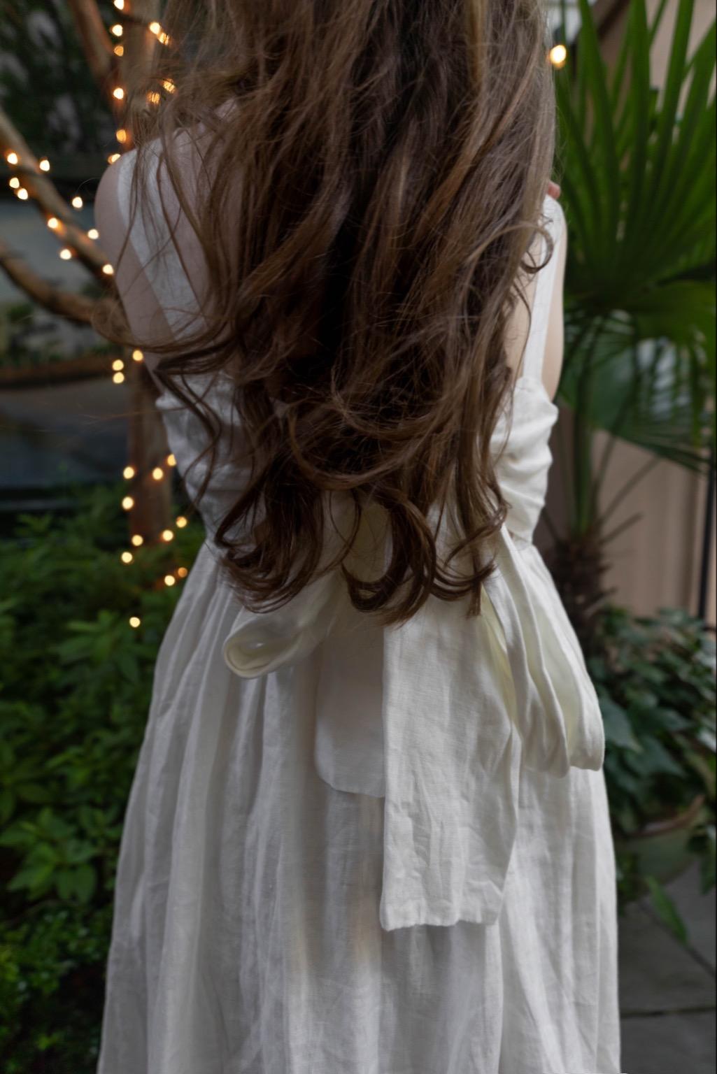 golden Greek Goddess-inspired Look Cara Cara White Linen Dress Styled by Annie Fairfax
