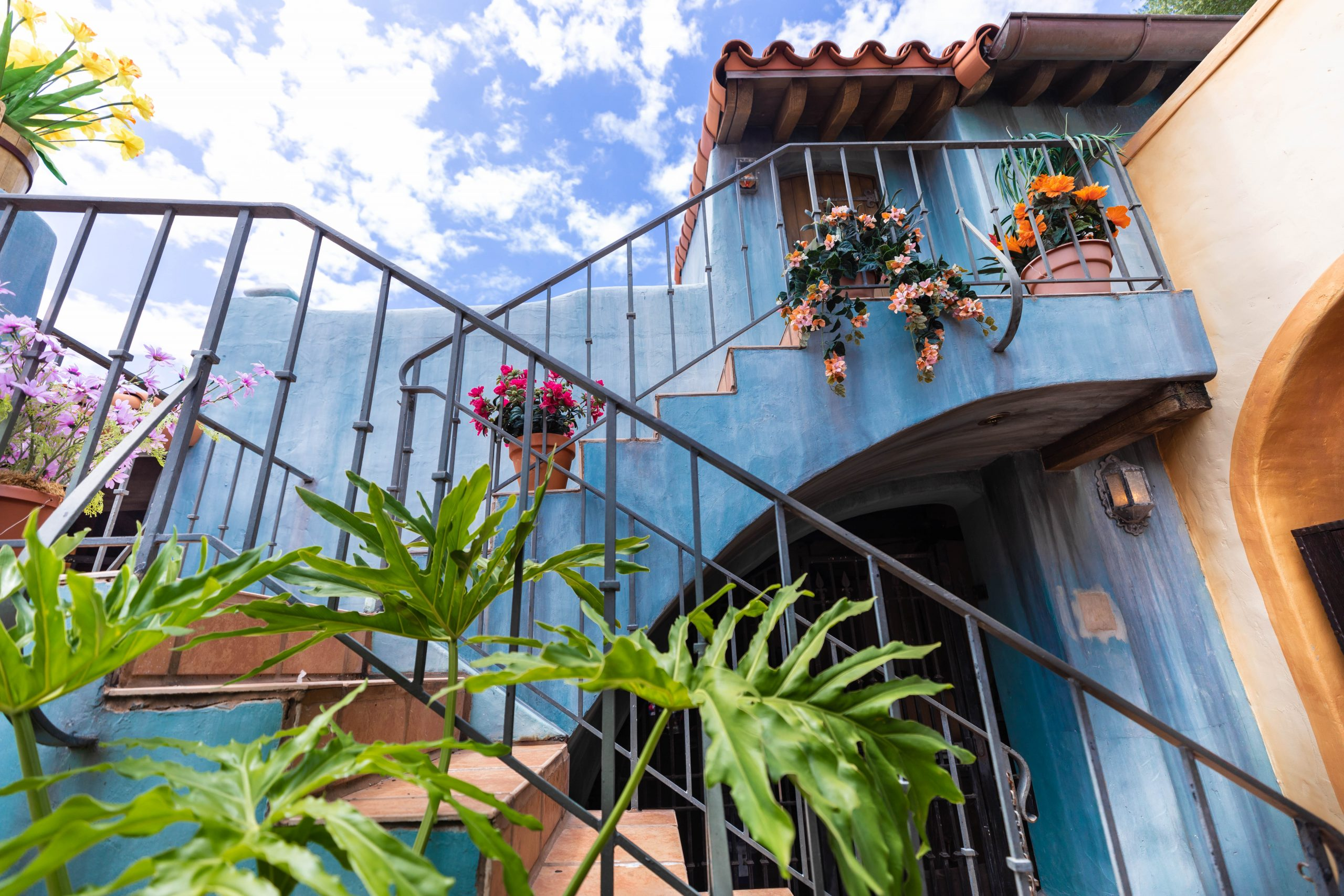 Blue Building Near Pirates of the Caribbean Ride at Magic Kingdom Walt Disney World in Orlando Florida Photographed by Luxury Travel Writer Annie Fairfax