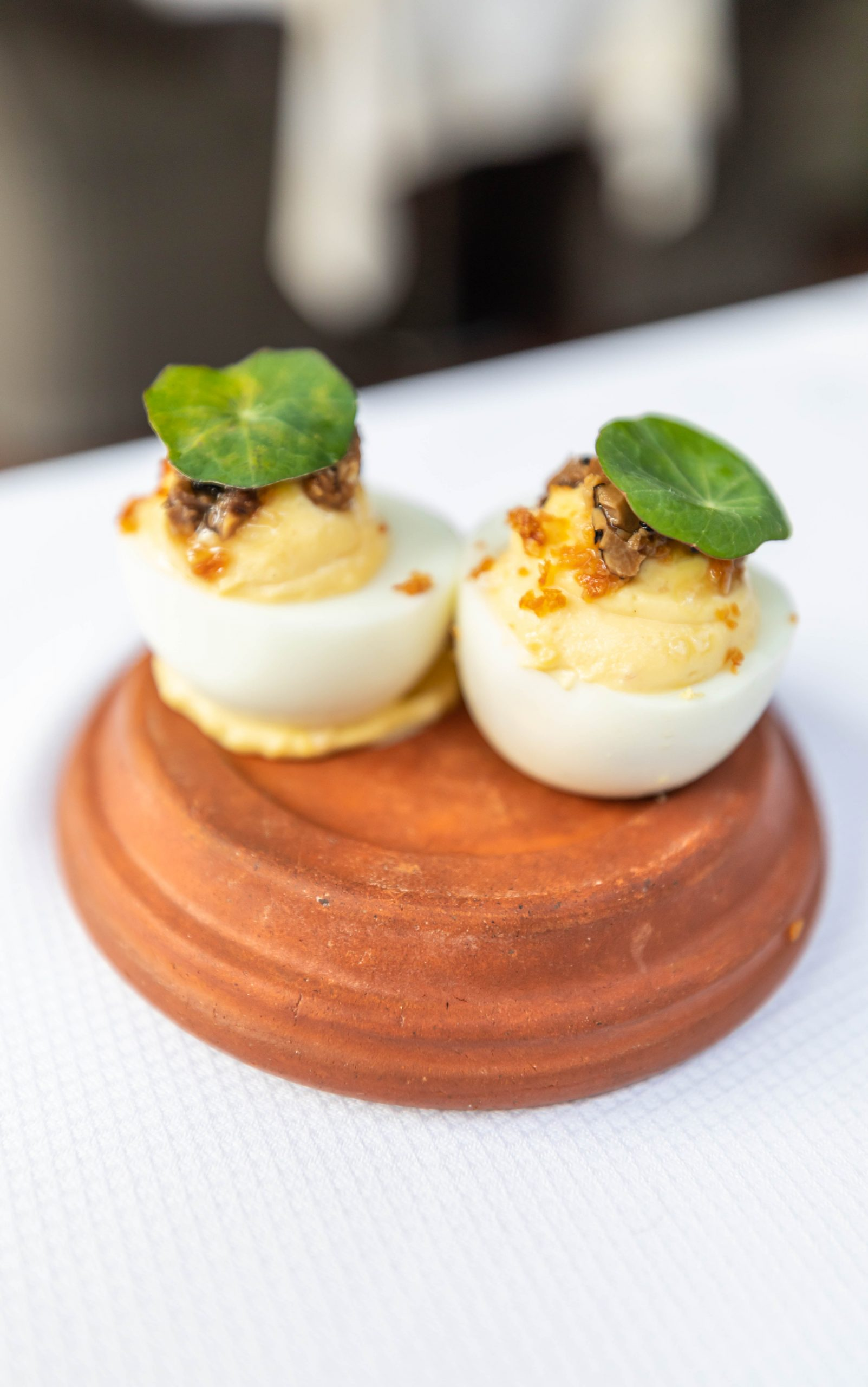 Deviled Eggs Appetizer Served on a Terra Cotta Lid at Zero George Restaurant + Bar in Charleston South Carolina Photographed and Written By Annie Fairfax Meal Prepared by Chef Vinson Petrillo