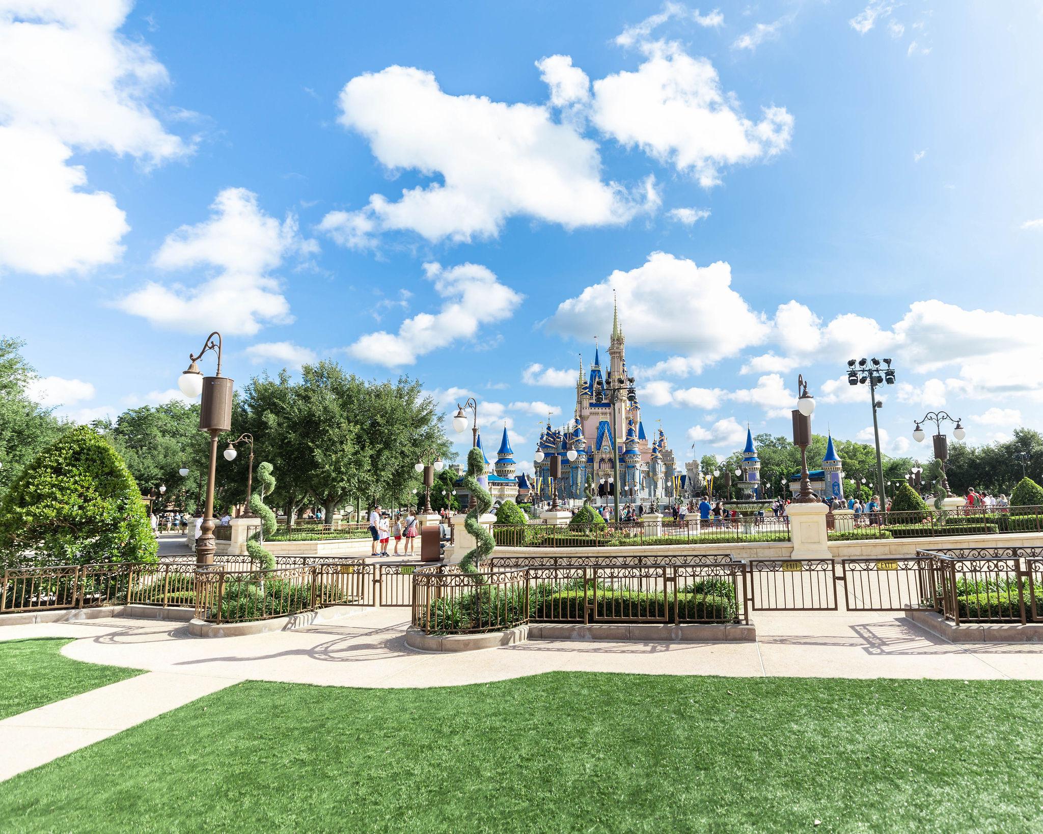 Walt Disney World Magic Kingdom Cinderella Castle & Hub Grass Photographed by Luxury Travel Writer Annie Fairfax