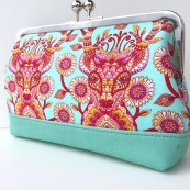 Tula Pink deers peer out from an Audrey Clutch