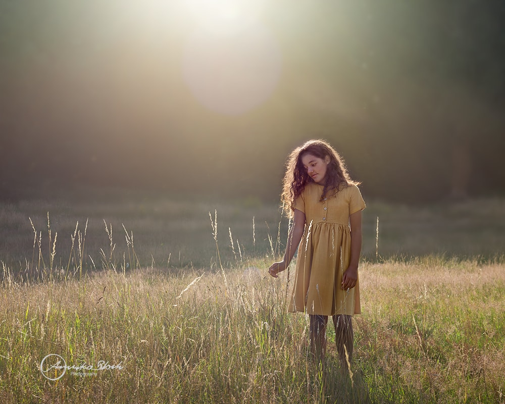 Fine art child photography, girl surrounded by nature
