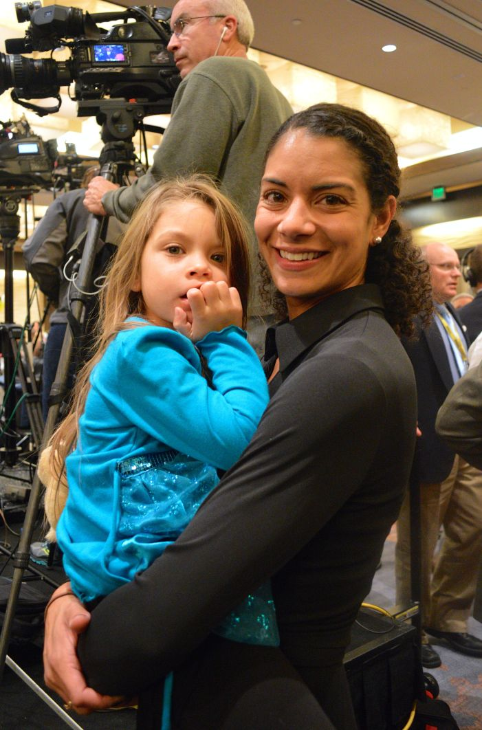 Frederick resident Monique Canale, 35, holding her 4-year-old daughter, Vanessa, at The Westin Annapolis, Republican gubernatorial candidate Larry J. Hogan Jr.'s election night headquarters. Canale's husband worked for The Hogan Companies and the two men are lifelong friends. Capital News Service photo by Annika McGinnis.