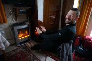 Finally warming the toes in front of our authentic electric fireplace