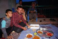 Huseyin and his brothers enjoying dinner