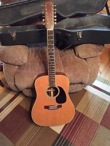 Kevin's date for the dance, a Takamine 12 String Acoustic
