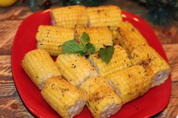Baked corn marinated with herbs and olive oil.