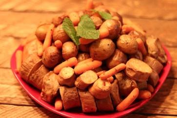 Baked sweet potatoes, baby potatoes, carrots, all marinated in olive oil, season all, rosemary, and Italian seasoning.
