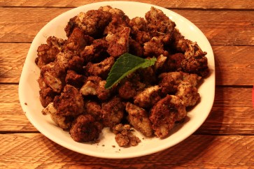 Fried cauliflower dipped in almond flour and herbs.